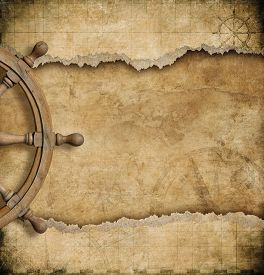 picture of steers  - steering wheel and torn vintage nautical map  - JPG