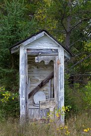 stock photo of outhouse  - Dilapidated Outhouse in the Rural Wisconsin Countryside - JPG