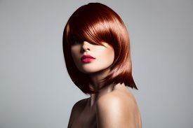 pic of hair dye  - Beautiful red hair model with perfect glossy hair - JPG