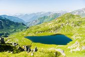 stock photo of italian alps  - High altitude blue lake in idyllic uncontaminated environment once covered by glaciers - JPG