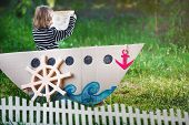 foto of pirates  - a kid plays in pirate at backyard - JPG