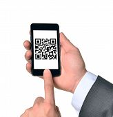 stock photo of qr codes  - Businessman touching smartphone with QR - JPG
