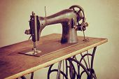 stock photo of sewing  - Old sewing machine on textured vintage background - JPG