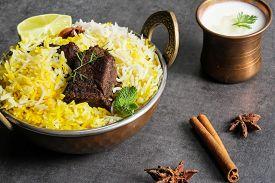 image of raita  - Beef biryani in a kadai with basmati ruce and raita - JPG