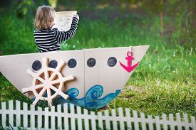 picture of pirates  - a kid plays in pirate at backyard - JPG