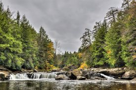 foto of maryland  - The Swallow Falls waterfall during Autumn in the western Maryland Appalachian mountains - JPG
