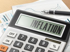 stock photo of calculator  - calculator with the word inflation on the display - JPG