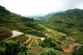 picture of ifugao  - rice terraces in banaue philippines on a cloudy day - JPG