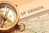 Antique Brass Compass Over Old Canadian Map poster