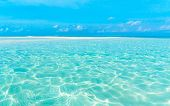 Beach and beautiful tropical sea. Caribbean summer sea with blue water. White clouds on a blue sky o poster