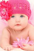 pic of tutu  - Close up beautiful 4 month old american baby girl in pink flower hat and tutu - JPG