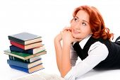 Young beautiful student girl with books on white background