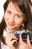 portrait pretty girl with photo camera over white