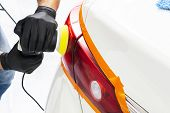 Car Polish Wax Worker Hands Holding Polisher And Polish. Close Up At Hand Holding Car Polisher. Man  poster