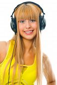 young woman listening music in head phones