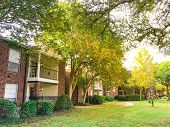 Typical Apartment Complex In Suburban Dallas Fort Worth, Texas In Fall Season Sunset poster