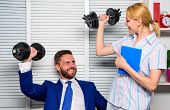 Healthy Habits In Office. Man And Woman Raise Heavy Dumbbells. Strong Powerful Business Strategy. Go poster
