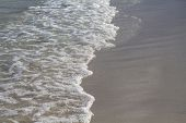 Sea Water Tide On White Sand Beach. Foamy Sea Wave On Smooth Sand. Tropical Seaside Photo. Summer Va poster