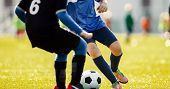 Soccer Players Running In Action. Football Match. Young Soccer Players Running With The Ball. Boys K poster