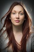stock photo of beautiful face  - beauty redheaded woman portrait on gray background - JPG