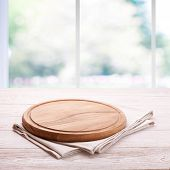 Board For Pizza And Tablecloth On Empty Wooden Table Near The Window In Kitchen. Canvas, Dish Towels poster