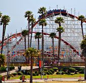 Front of the Santa Cruz Beach Boardwalk amusement park featuring the historic Big Dipper wooden rollercoaster