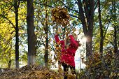 Fall Clothes And Fashion Concept. Child Blonde Long Hair Walking Fall Park Background. Girl Happy We poster