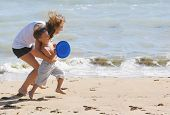 happy mother and son playing on beach