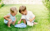 two kids playing with butterfly net