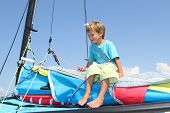 young boy on board of sea catamaran