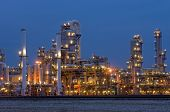 A petrochemical plant, with it's stainless steel cylinders, it's valves, chimneys, pipes, tubes and