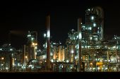 Petrochemical industry, showing stainless steel tubes and pipes at night