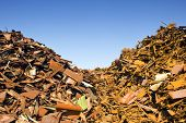 two heaps of different kinds of metal scrap in a scrap yard