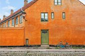 Yellow Walls Of Historical Building In Traditional Style In Copenhagen, Denmark. Bicycle Parked Past poster