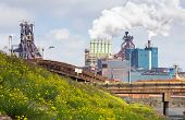 Steel works on a hot summer day. Heat emerges from the plant,