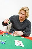 A Poker player deciding on the size of his bet