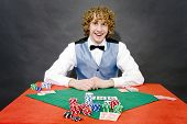 A smiling poker dealer, ready for a game