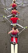 Close up of a coxed four rowing team, seen from above