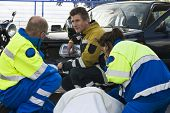 stock photo of sidecar  - fireman and paramedic discussing the course of action - JPG