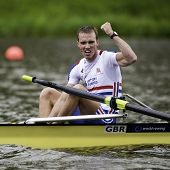 AMSTERDAM-JULY 23: Chambers (GBR BLM2-) cheers, winning gold medal in a world record time of 6:26.90