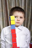 Boy And Color Brick Tower