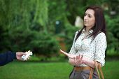 attractive young brunette female refuse to take cigarette from friend, park shoot