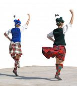Two Highland dancers on a stage.