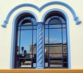 picture of art nouveau  - Art Deco Buildings reflected in an art deco window - JPG