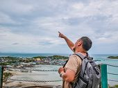 Asisn Fat Backpacker Stand On Top Of  Khao Ma Jor Pier  With Idyllic Ocean Beautiful White Cloud End poster