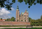 Park With Beautiful Brick Walls Of Rosenborg Castle, Built In 17th Century. Historical Landmarks Of  poster