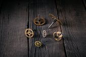 Clockwork Gears On Wooden Boards. Good Idea Vintage, Time From The Inside. poster