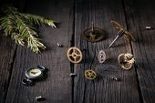 Old Watches, Clockwork - Gears, Screws, Twig Of The Christmas Tree On Wooden Boards. Good Idea Vinta poster