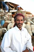 Arab shepherds at the livestock market in Doha, Qatar, with their flock. No release, editorial use o