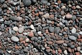stock photo of scoria  - An assortment of tephra and pyroclastic pebbles on Red Beach - JPG